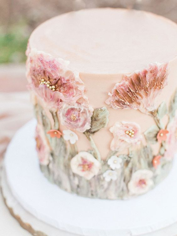 a delicate blush wedding cake with sugar pink blooms and foliage is a gorgeous idea for a secret garden wedding