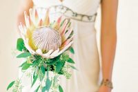 22 a king protea is a large bloom that is enough for a small and catchy bouquet, though you may add greenery, too