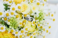 23 a colorful spring or summer wedding bouquet of yellow ranunculus, daisies, white blooms and greenery is a cheerful and fun idea to rock