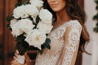23 a lovely and chic white rose wedding bouquet with neutral ribbons is a chic and refined idea for any bride, such a combo always works