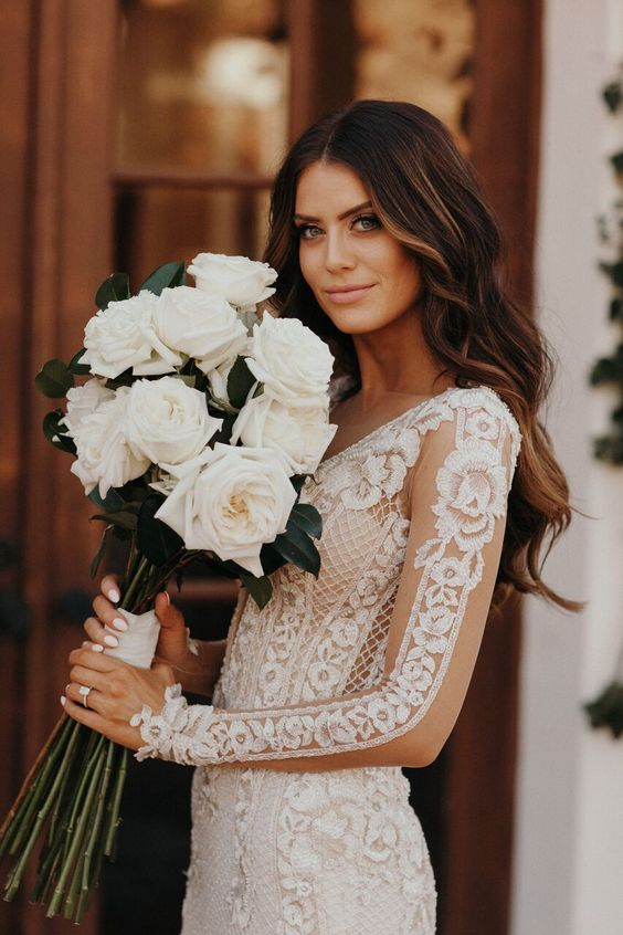 a lovely and chic white rose wedding bouquet with neutral ribbons is a chic and refined idea for any bride, such a combo always works