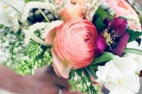 24 a colorful wedding bouquet with pink ranunculus, purple blooms, berries, lots of greenery and creative fillers is amazing