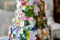 24 a gorgeous secret garden wedding cake decorated with bold and pastel sugar blooms and leaves is a lovely idea