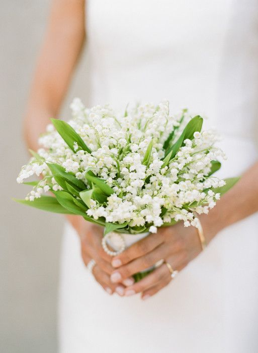 a pretty and small wedding bouquet of lily of the valley is a gorgeous and fabulous idea for a spring bride