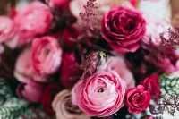 25 a jewel-tone wedding bouquet of pink ranunculus and fuchsia roses, some dark and usual foliage is amazing for fall