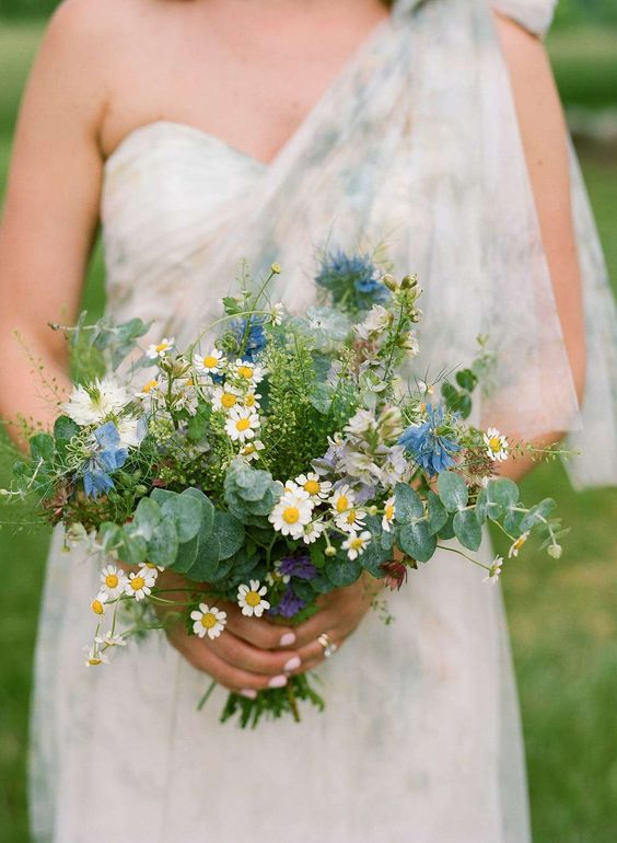 a creative spring wedding bouquet of daisies, blue and white blooms, eucalyptus is a very fresh and lovely idea to try