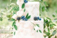 26 a heavenly secret garden wedding cake with sugar floral detailing, fresh berries and some foliage is a delicate and refined idea