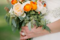 26 a lovely wedding bouquet of blush peonies, orange ranunculus and greenery is amazing and super bold