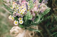 27 a cute wildflower wedding bouquet of daisies, waxflowers, astilbe and lavender plus greenery for a relaxed summer boho wedding