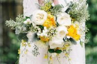 27 a pretty and bright wedding bouquet of white peonies, yellow ranunculus, greenery, waxflowers and berries is a lovely and bold idea