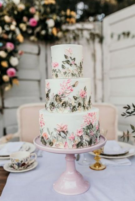 a light green wedding cake with sugar pink flowers and foliage is a fantastic idea for a secret garden wedding