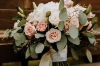 28 a white rose and blush rose wedding bouquet refreshed with eucalyptus and white ribbons looks very dreamy and very chic