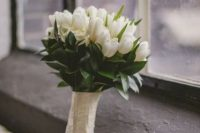 30 a white tulip wedding bouquet is classics for a spring bride, and you can easily compose one yourself without any help