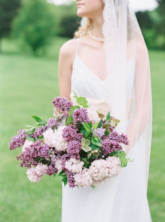 a wildly romantic blush and purple lilac wedding bouquet is a gorgeous idea for a garden bride, for a spring or summer one
