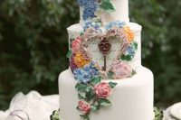 31 an enchanting secret garden wedding cake in white decorated with pastel blooms and foliage of sugar is wow