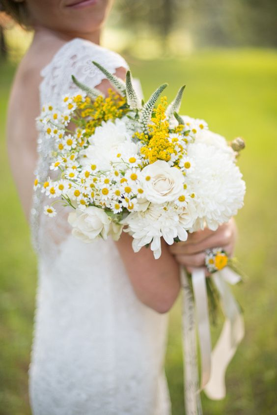 a lovely summer wedding bouquet of white dahlias, astilbe, white roses, daisies and some neutral ribbons is a chic and beautiful idea