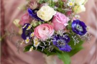 34 a lovely wedding bouquet of daisies as fillers, pink ranunculus and roses, purple anemones, greenery is a simple and cool idea