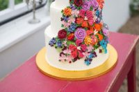 36 a colorful secret garden wedding cake in white with super brigth sugar blooms is amazing and makes a statement with color