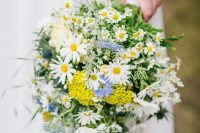 36 a lovely wedding bouquet with daisies, blue and mustard blooms and greenery is a simple and pretty idea for a rustic wedding