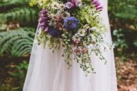 40 a wildflower wedding bouquet with daisies, pink and purple blooms and greenery features creative textures and a dimension