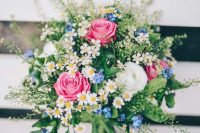 41 pink roses, white ranunculus, blue forget-me-not, daisies and greenery for a very inspiring and beautiful summer wedding bouquet