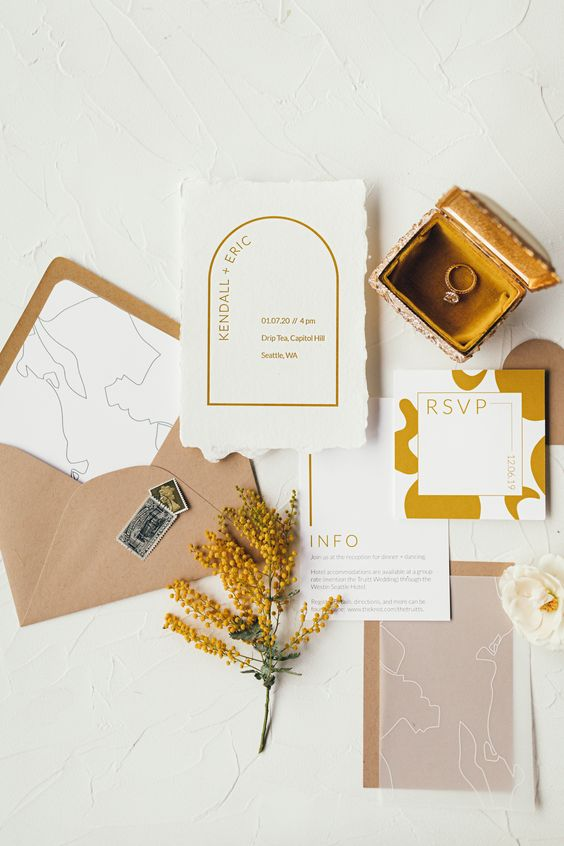 a beautiful abstract wedding invitation suite with a peachy envelope, mustard and gold touches, a raw edge is a lovely idea for a modern wedding