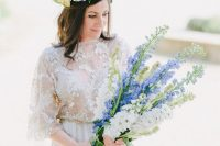 a beautiful blue and white delphinium wedding bouquet with blue ribbons is a lovely and romantic idea for a spring bride