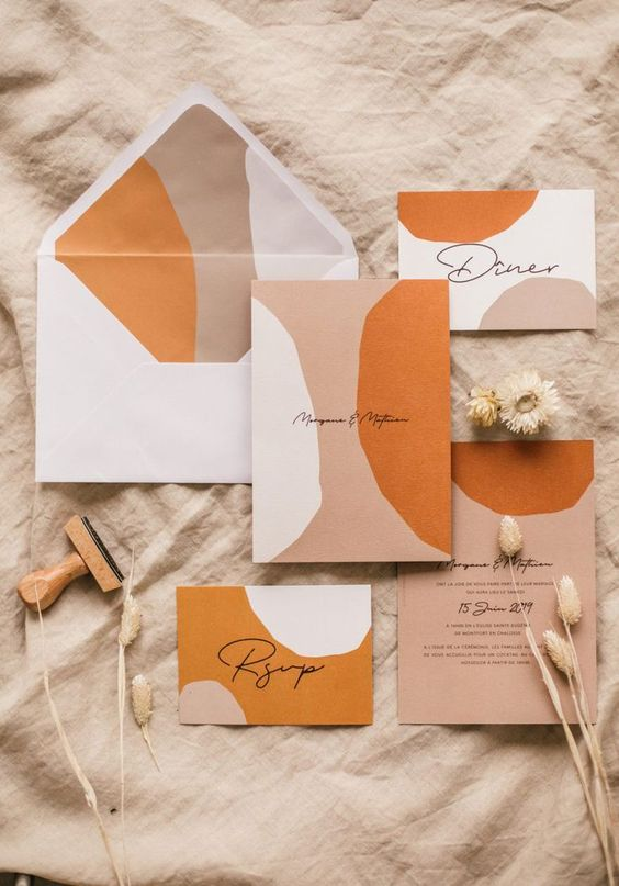 a beautiful boho abstract wedding stationery suite in grey, white, rust, blush and with delicate calligraphy is a gorgeous idea for a fall wedding