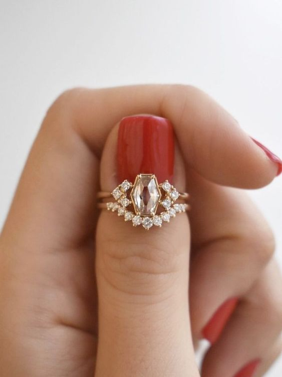 a beautiful lemon gold stacked wedding ring with an unexpectedly shaped diamond, with an arched diamond ring is very chic