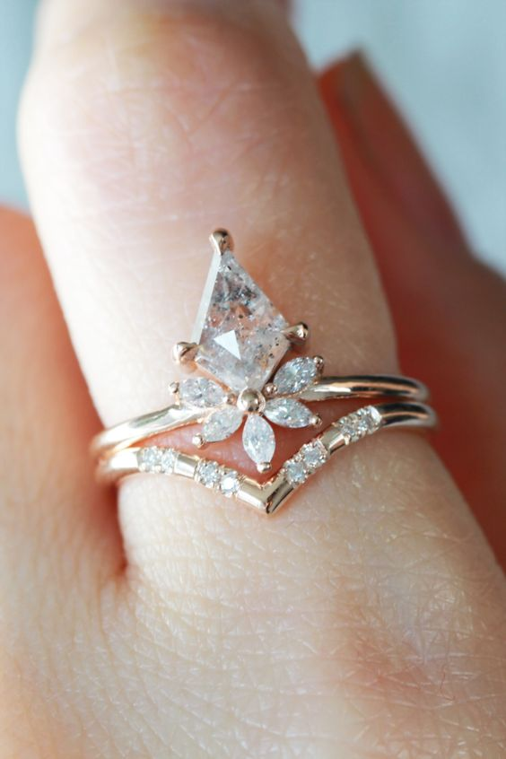 a beautiful stacked engagement ring with a large rhomb opal and diamonds and a lower triangle one with small diamonds