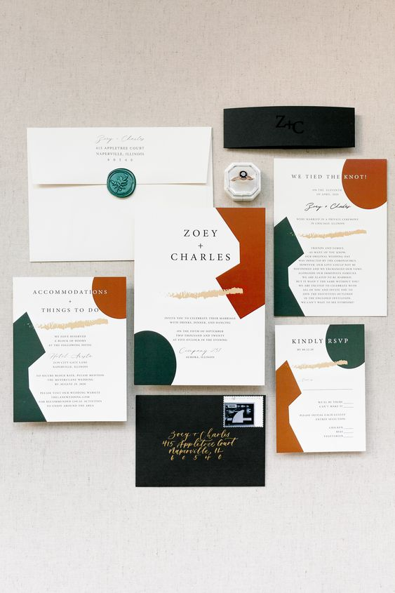 a bold modern abstract wedding invitation suite with rust, emerald and tan touches, with gold and black lettering