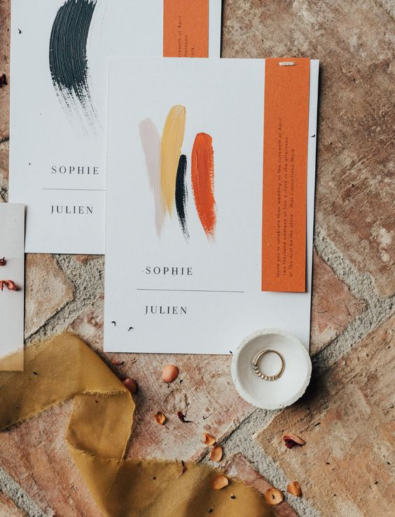 a bold wedding invitation suite in orange, yellow, grey, navy and with elegant modern letters is a chic solution