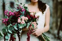 a bright long stem wedding bouquet with pink garden roses and hot pink and burgundy blooms plus twigs and euclayptus is amazing