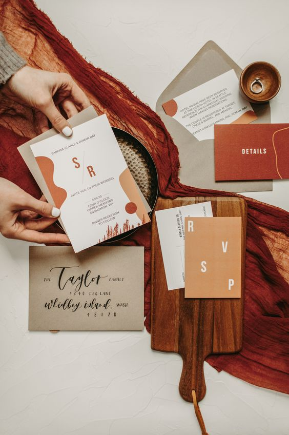 a bright wedding invitation suite with rust, burgundy, grey touches, with fun and bold modern lettering for a fall wedding