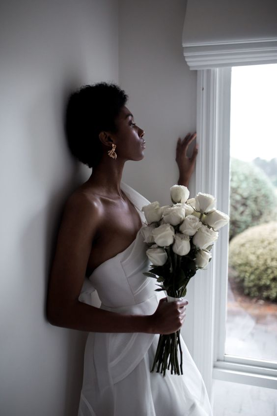 a chic and elegant white rose long stem wedding bouquet will never go out of style and will make your look very refined