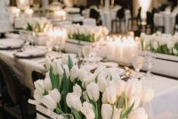 a chic and luxurious wedding centerpiece of a box with white tulips is a beautiful solution for a modern lux wedding