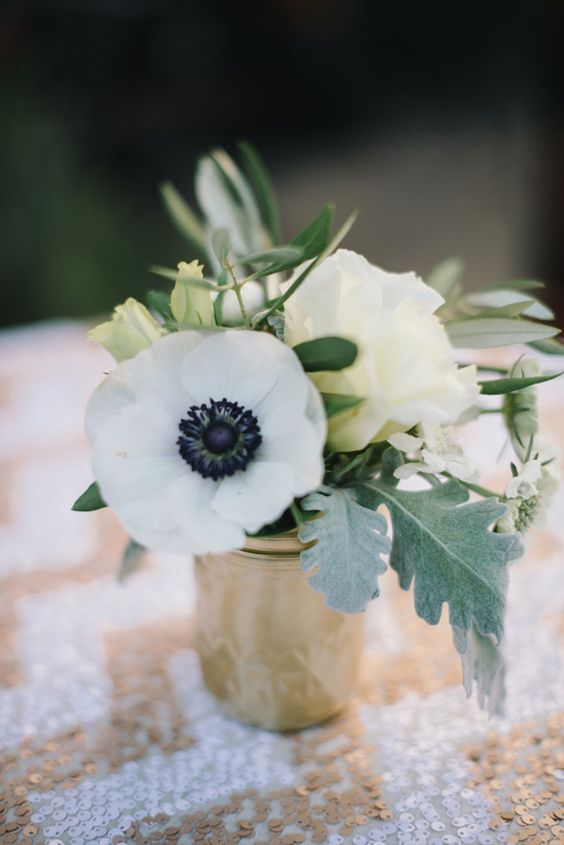 a chic anemone and rose wedding centerpiece with greenery and pale leaves is a cool and very simple idea to try