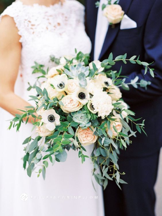 a chic wedding bouquet of lots of greenery, white anemones, peachy and white peonies is a lovely idea to go for
