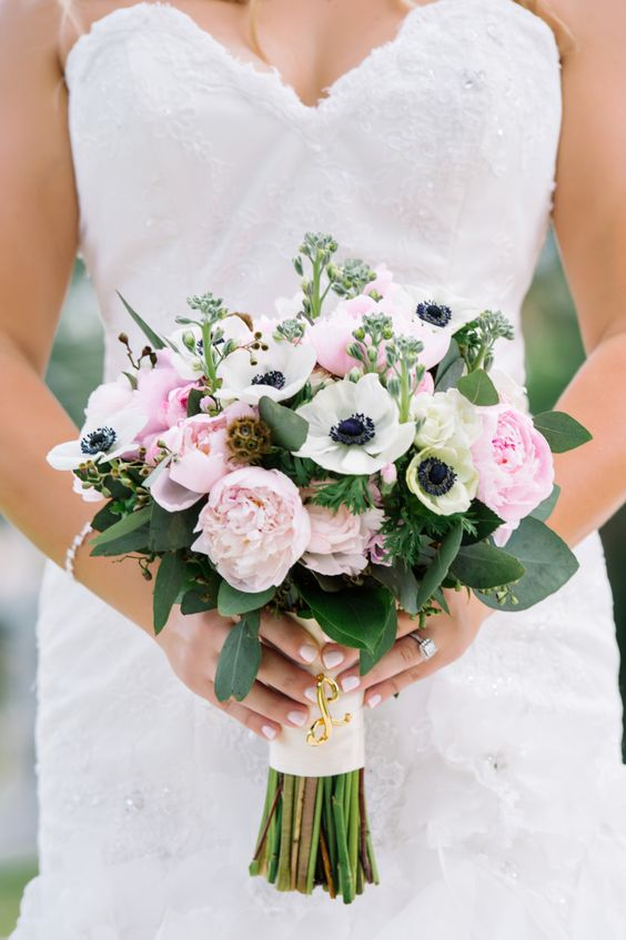 a chic wedding bouquet of pink peonies, white anemones and eucalyptus is timeless classics for spring or summer