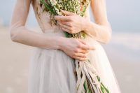 a coastal bride rocking a long stemmed wedding bouquet with small blooms is a very delicate and chic idea to rock