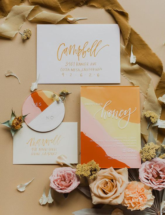 a colorful modern wedding invitation suite with bold orange, yellow, pink, red touches and gold and white calligraphy is a lovely idea for a summer wedding