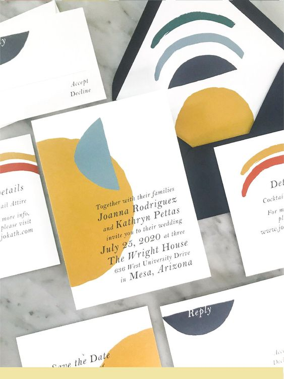 a colorful summer wedding invitation suite in black, grey, green, mustard and blue inspired by summer sunrises