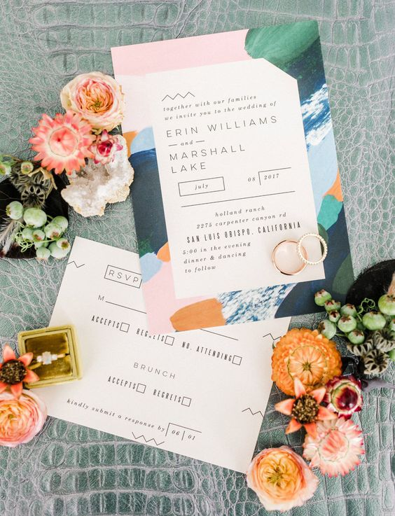 a colorful wedding invitation in pink, green, blue, rust, with abstract touches inspired by the jungle