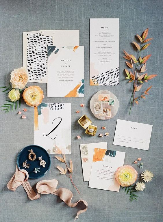 a colorful wedding invitation suite with teal and orange touches, with bold lettering and fun patterns is a lovely idea