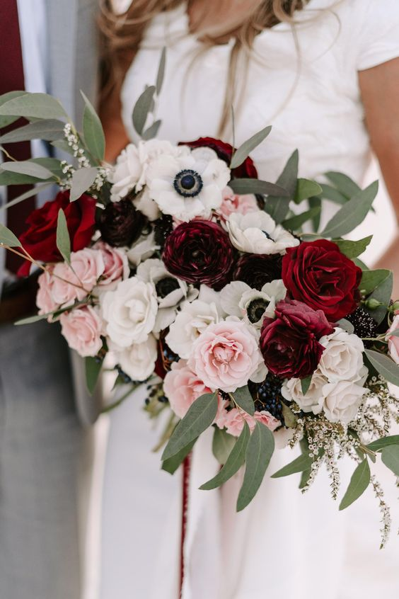a contrasting wedding bouquet of pink, burgundy and blush roses, white anemones and greenery is a chic idea to rock