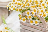 a crate box with daisies is a lovely and cool rustic wedding idea to rock – such a centerpiece is very bright and inspring