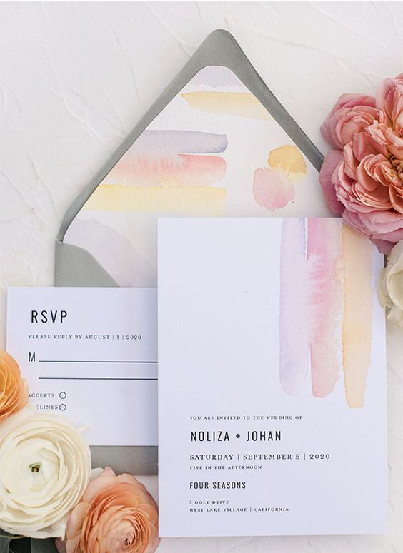 a delicate abstract watercolor wedding invitation suite in grey, pink and yellow, with stylish  modenr letters