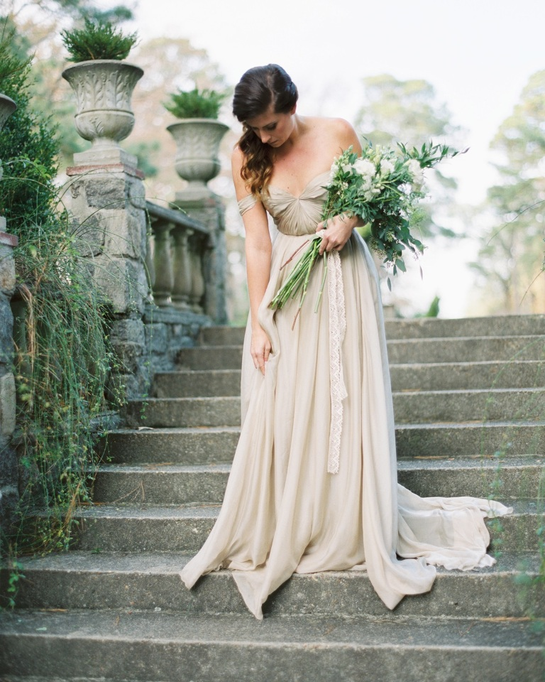 a delicate greenery and white bloom wedding bouquet with white lace ribbons is a chic and very subtle option of a bouquet