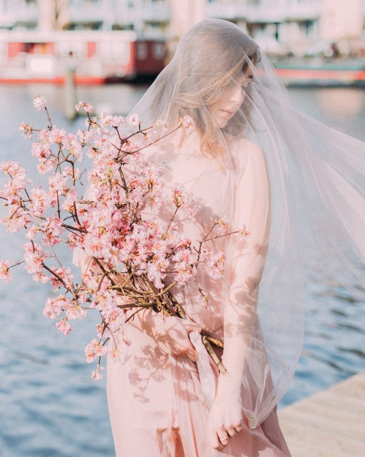 a cute wedding bouquet that consist of cherry blossoms