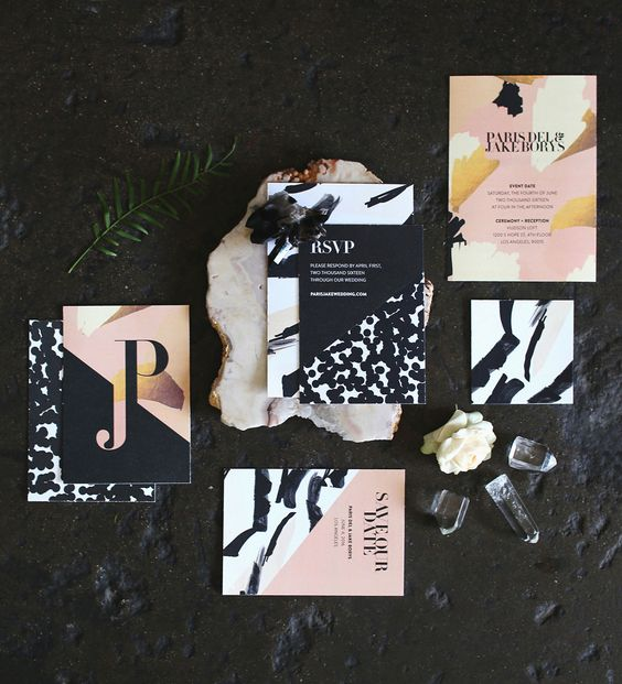a gorgeous bold wedding invitation suite with black, white, blush and mustard touches and various abstract patterns